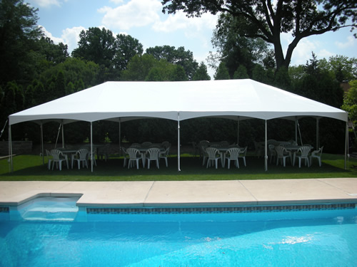 Photo Of A White Tent Set Up For Backyard Party In New Jersey